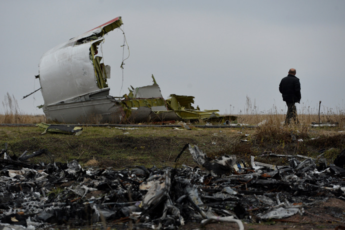 A man on the crash site of the MH 17 Malaysian Boeing that was en route from Amsterdam to Kuala Lumpur.
