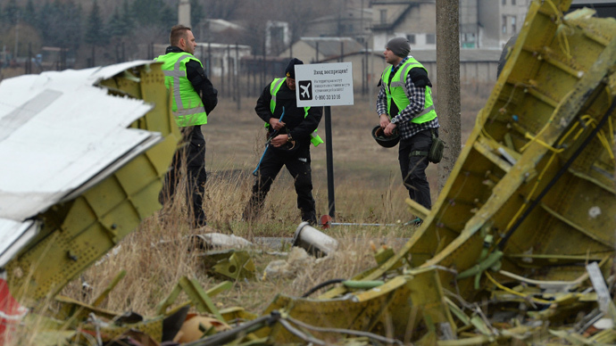 Dutch experts work at Malaysia Airlines Flight MH17 Amsterdam - Kuala Lumpur crash site.